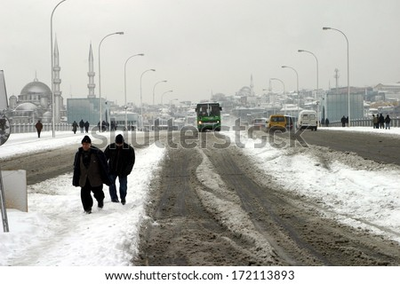 ISTANBUL, TURKEY - JANUARY 23: People trying to go to work on a snowy day in Eminonu District on January 23, 2007 in Istanbul, Turkey. - stock photo
