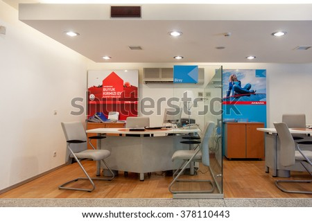 ISTANBUL, TURKEY - JULY 28, 2009: AKBANK office seen from the street with empty tables and chairs. AKBANK is the largest and most profitable bank in Turkey - stock photo
