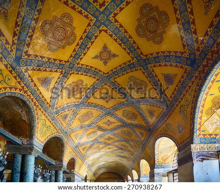 ISTANBUL, TURKEY - JULY 9, 2014: Ceiling mosaic decoration with original styled Christian cross in the Upper Gallery of the Hagia Sophia. Istanbul, Turkey - stock photo