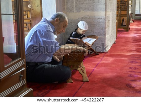 ISTANBUL, TURKEY - JULY 1: Edirnekapi Mihrimah Sultan Mosque in reading Koran muslim, 1 July 2016 in Istanbul Turkey. The Muslims who have made a tradition of reading Koran the month of Ramadan. - stock photo