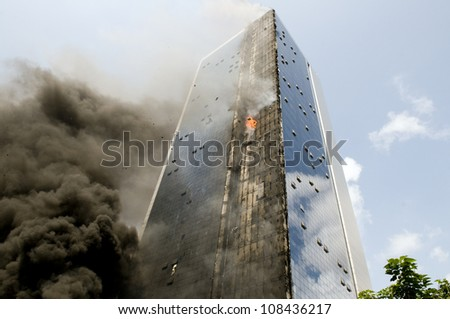 ISTANBUL, TURKEY - JULY 17: Istanbuls Polat Tower burned for still unknown reason, the building is damaged on July 7, 2012 in Istanbul, Turkey. - stock photo