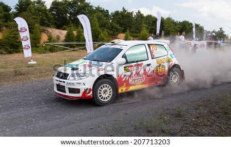 ISTANBUL, TURKEY - JULY 13, 2014: Murat Soycopur drives Fiat Palio S1600 of Pegasus Racing Team in 35. Istanbul Rally, Gocbeyli Namet Stage - stock photo
