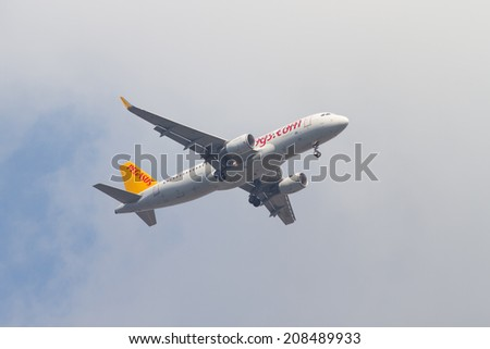 ISTANBUL, TURKEY - JULY 13, 2014: Pegasus Airlines Airbus A320-214 landing to Sabiha Gokcen Airport. Pegasus is the second largest airlines in Turkey with 43 airplanes. - stock photo