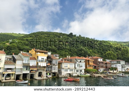 ISTANBUL, TURKEY, JUNE 8, 2013: Detail from the coastline houses at Anadolu Kavagi, a touristic small fishing town at the edge of Bosphorus, Istanbul, Turkey. - stock photo