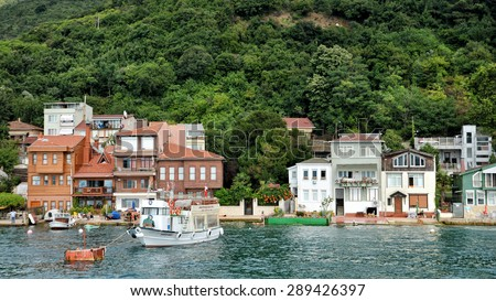 ISTANBUL, TURKEY, JUNE 8, 2013 :Houses at the coastline of Anadolu Kavagi, a famous fishing town at the edge of Bosphorus with many restaurants and touristic facilities.  - stock photo