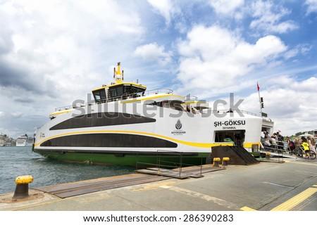 ISTANBUL,TURKEY, JUNE 11,2015: Newly designed Sh Goksu ferry docked at Uskudar pier at Eminonu District.  Sehir Hatlari's new ferries look different than Istanbul's traditional passenger ferries. - stock photo