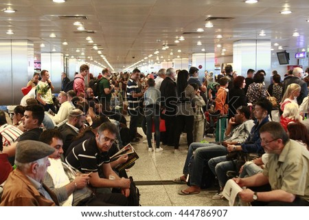 ISTANBUL, TURKEY - June 01, 2015: Tourists are waiting in a crowded space near the gates for the delayed flight in Turkey's largest airport, Istanbul Ataturk, Turkey. - stock photo