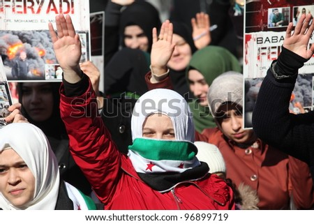 ISTANBUL,TURKEY-MARCH 2:A group of unidentified people stage a demonstration in front of the Beyazit Mosque, protesting Syrian authorities' violent crackdown in Homs,on March 2,2012 in Istanbul,Turkey - stock photo