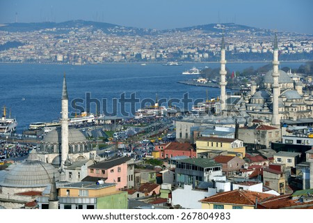 ISTANBUL, TURKEY - MARCH 23, 2014: Aerial view to Bosporus strait and Yeni Mosque. Built in 1665, the mosque is situated on the Golden Horn and is one of the famous architectural landmarks of Istanbul - stock photo