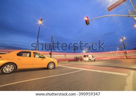 Istanbul, Turkey; March 10, 2016: Long Exposure traffic lights,cars and pedestrians image with light painting during twilight - stock photo