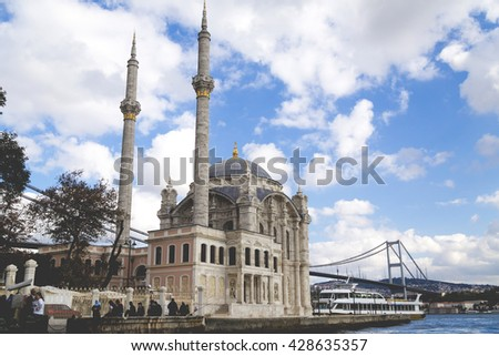 Istanbul, Turkey - March 16, 2016: Mecidiye Mosque in Ortakoy, facing the Bosphorus and the Bosphorus Bridge, Istanbul, Turkey. - stock photo