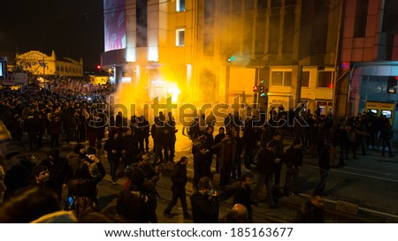 ISTANBUL, TURKEY - MARCH 11, 2014: People gathered in Kadikoy to protest after Berkin Elvan, who was 15 years old, died. He was hit in the head with a tear gas canister by Police. - stock photo