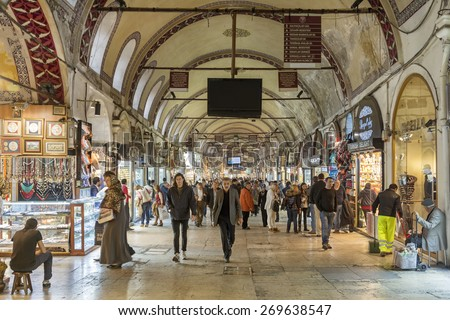 Istanbul, Turkey - March 26, 2015: The Grand Bazaar in Istanbul is one of the largest and oldest covered markets in the world, with 61 covered streets and over 3,000 shops. - stock photo