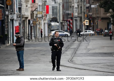 ISTANBUL, TURKEY - MARCH 19: Turkish policemen stand in a cordon off street after a suicide bomb attack at Istiklal Street in Istanbul on March 19, 2016 in Istanbul, Turkey. - stock photo