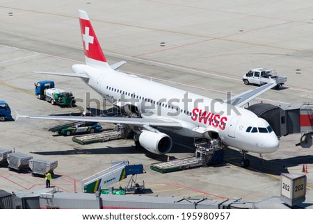 ISTANBUL , TURKEY - MAY 23, 2014: Aircraft of Swiss Airlines, is parking at  Istanbul Ataturk International Airport on May 23, 2014. The aircraft is an Airbus A-320  - stock photo
