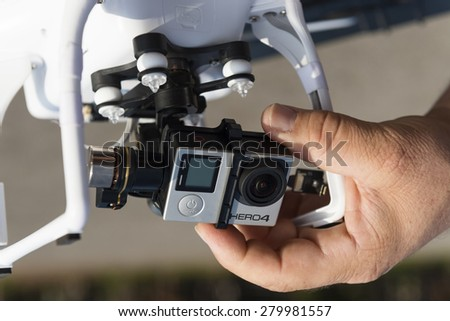ISTANBUL, TURKEY - MAY 19 ,2015: Drone quadrocopter Dji Phantom 2 with digital camera GoPro HERO4 Black edition. New tool for aerial photo and video. - stock photo