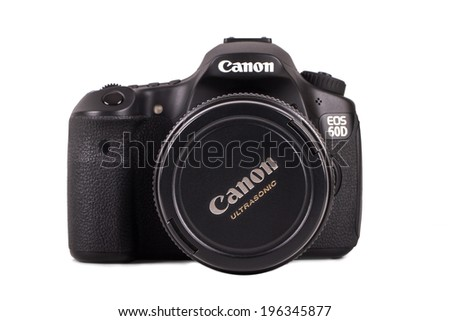 ISTANBUL, TURKEY - MAY 19, 2014: Front view of Canon 60D camera, isolated on white background. - stock photo