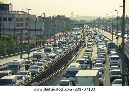 ISTANBUL, TURKEY, MAY 26, 2015: Heavy traffic jam at the entrance of Mecidiyekoy District, one of the most populated financial districts of Istanbul, Turkey. - stock photo