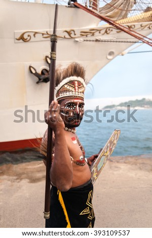 ISTANBUL, TURKEY - MAY 28, 2010: Native Indonesian man smiling at an indigenous tribe in parade Karakoy Istanbul. Indonesian antique pride sailing ship Dewaruci visited Istanbul.  - stock photo