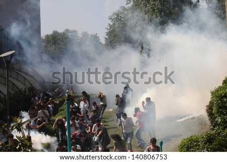ISTANBUL,TURKEY-MAY 31: Police forces attacked Taksim Gezi Park protesters with tear gas and water cannons as protests continue for a fourth day on May 31, 2013 in Istanbul,Turkey. - stock photo