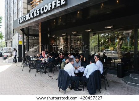 ISTANBUL, TURKEY - MAY 13, 2016:Starbucks coffeehouse in istanbul on MAY 13, 2016 in Istanbul. Starbucks is the largest coffeehouse company in the world, with almost 20,000 stores in 58 countries - stock photo