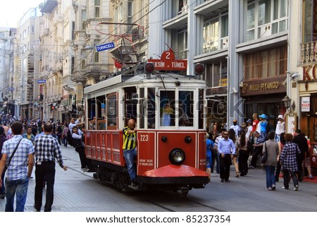 ISTANBUL, TURKEY - MAY 25 : Taksim Istiklal Street at eventide on May 25, 2011 in Istanbul, Turkey. Taksim Istiklal Street is a popular tourist destination in Istanbul. - stock photo