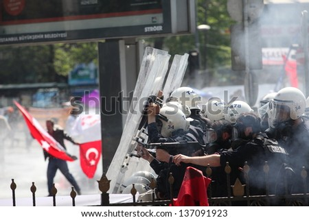 ISTANBUL, TURKEY - MAY 1: The demonstrators who are against to prohibition of 1 May celebration were arrested by the police on May 1,2013 in Istanbul,Turkey - stock photo