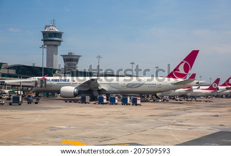 ISTANBUL, TURKEY - MAY 04: Turkish Airlines aircraft parked in the Istanbul Ataturk Airport, on May 04 2014 in istanbul Turkey.  17th busiest airport in the world.  - stock photo
