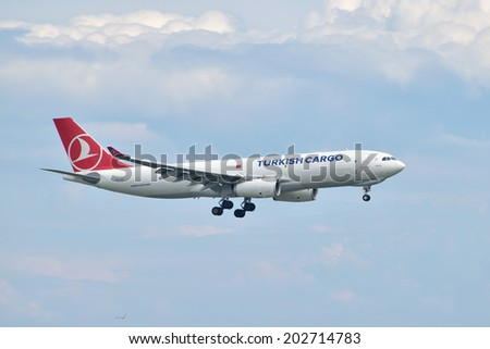 ISTANBUL, TURKEY - MAY 2, 2014: Turkish Cargo Airbus A330 landing at Istanbul Ataturk Airport.  This aircraft, TC-JCI, was delivered to Turkish Airlines Cargo in 2013. - stock photo