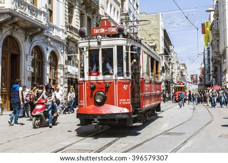 ISTANBUL, TURKEY - MAY 15, 2015: Vintage tram on the Taksim Street in Istanbul, Turkey. Nostalgic tram of Istanbul is the heritage tramway system. It was re-established in 1990. - stock photo