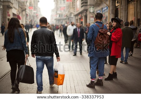 Istanbul,Turkey - November 11,2015 : Crowds of people walk and make shopping in Istiklal street,Istanbul - stock photo
