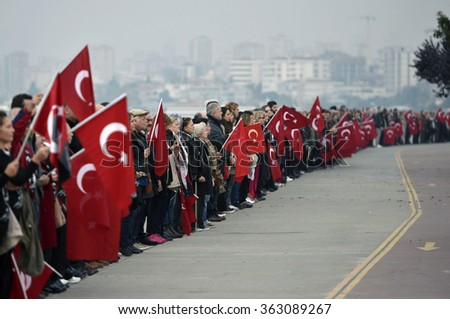 Istanbul, Turkey - 10 November 2015: Turkish people wait a minute's silence at anniversary dead of Mustafa Kemal Ataturk - stock photo