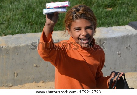 ISTANBUL, TURKEY OCTOBER 6: An unidentified little girl sell paper tissue for help to live on oct, 6 2013. Turkey'Â?Â?s child poverty rate of 24.6 percent. - stock photo