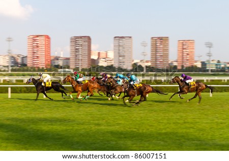 ISTANBUL, TURKEY - OCTOBER 02: Unidentified riders in the home stretch of 6th race on October 02, 2011 in Veliefendi Racecourse, Istanbul, Turkey. - stock photo