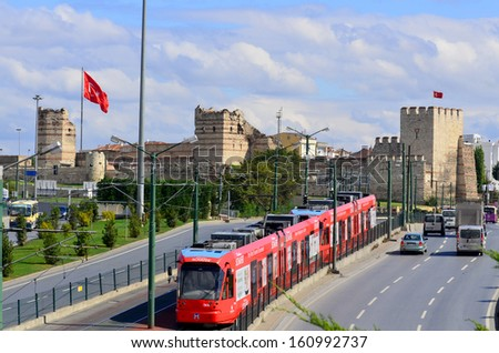 ISTANBUL TURKEY SEPT 25 A modern tram on Sept 25, 2013 in Istanbul Turkey. Due to increasing traffic & air pollution, Istanbul became one of most polluted city also planned for return of tram. - stock photo