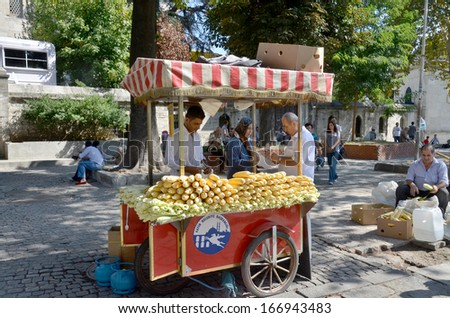 ISTANBUL TURKEY SEPT 28: Young man sells corns for to live in down town Istanbul Turkey on september 28 2013. Street vendors are omnipresent on Istanbul�s street.  - stock photo