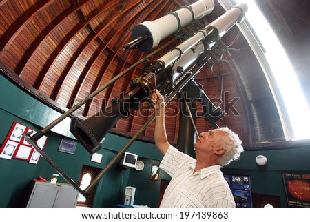 ISTANBUL, TURKEY - SEPTEMBER 2: Astronomical observatory telescope at the Kandilli Observatory on September 2, 2009 in Istanbul, Turkey. Observatory, which is also specialized on earthquake research. - stock photo