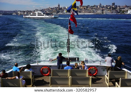 ISTANBUL, TURKEY - SEPTEMBER 25, 2015: People travel on a ferry from Eminonu to Kadikoy in Istanbul, Turkey - stock photo