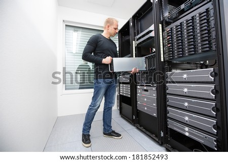 It consultant install blade server in datacenter - stock photo