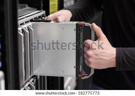 IT consultant installs Blade Server - stock photo