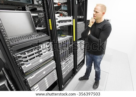 IT consultant try to solve problems in datacenter - stock photo