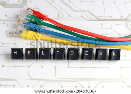 IT HELP, Assistance - HELPDESK made of keyboard keys with colourful network cables on white circuit board background - stock photo