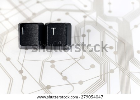 IT Help desk - Two Black Keyboard keys with letters I and T on White Circuit Board Background - stock photo