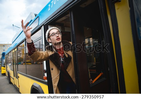 It helps to go on the bus. public transport. help. pulling arm - stock photo