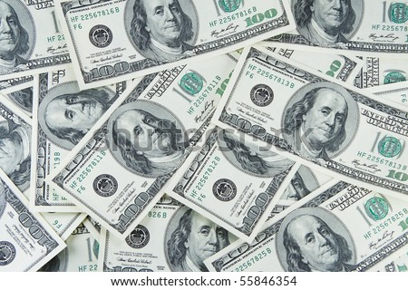 It is a lot of denominations of dollars in the form of a background - stock photo