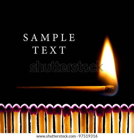 It is a lot of matches on a black background. One match burns. - stock photo