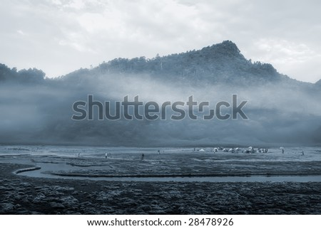It is a river with mist and mountain. - stock photo