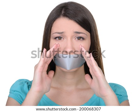 It is better to be silent. Upset girl with self-adhesive tape over her mouth - stock photo