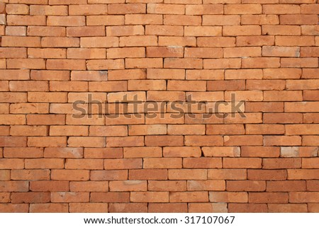 It is Design on orange brick wall for pattern and background. - stock photo