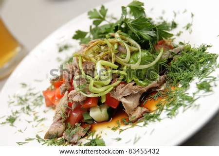 It is fish salad with cheese in the restaurant - stock photo